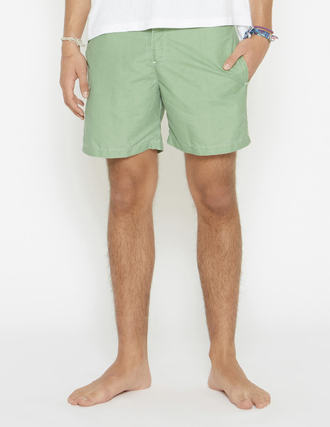 Green distressed swimming trunks